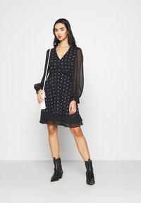 Miss Selfridge - MIXED SPOT DRESS - Day dress - black - 1