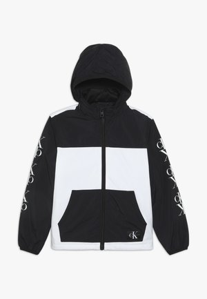 PACKABLE MIRROR MONOGRAM JACKET - Light jacket - black