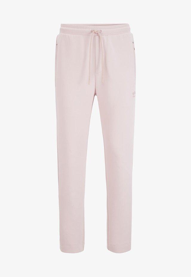 HURLEY - Tracksuit bottoms - light pink