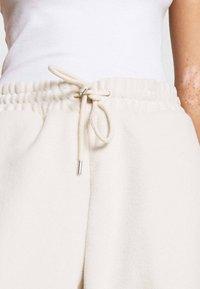 Monki - FANNY TROUSERS - Pantalones deportivos - beige - 5