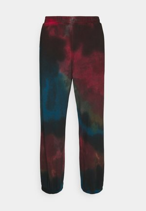 STANDARD TIE DYE SWEATPANTS - Tracksuit bottoms - black/purple