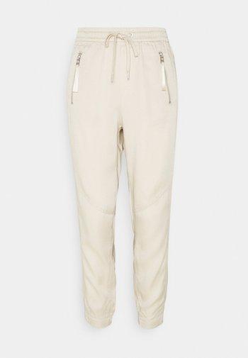 Teplákové kalhoty - light sand