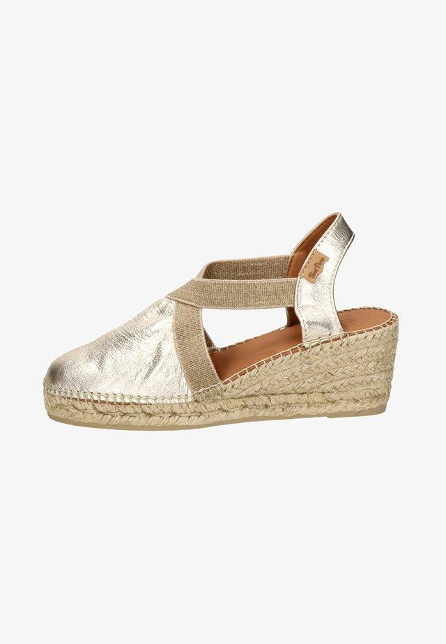 Sandalen met sleehak - goud