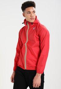 K-Way - CLAUDE 3.0 UNISEX  - Summer jacket - red - 0