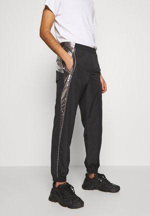 PANTS - Tracksuit bottoms - black/silver