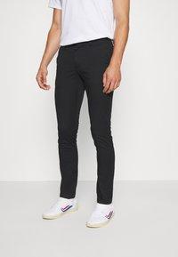 Tommy Hilfiger - BLEECKER FLEX SOFT  - Trousers - black - 0