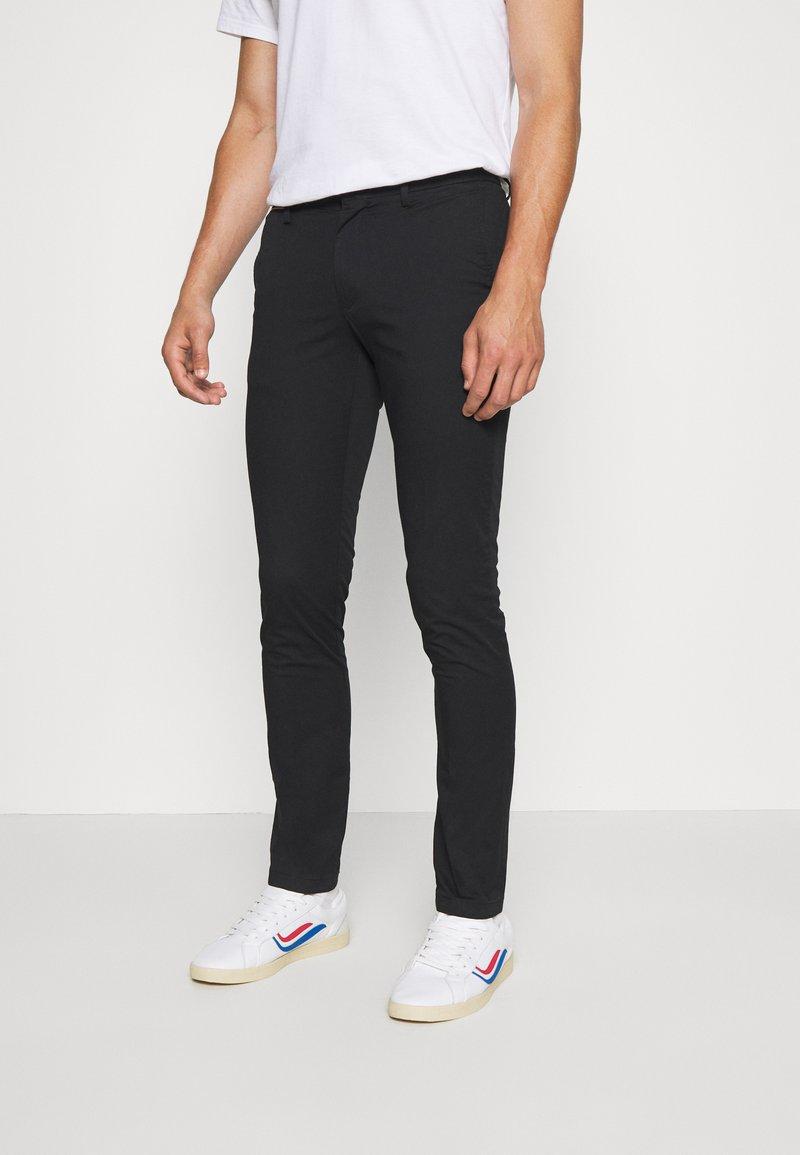 Tommy Hilfiger - BLEECKER FLEX SOFT  - Trousers - black