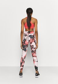 ONLY Play - ONPJABINA LIFE TRAIN - Leggings - peachskin/black - 2
