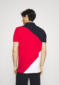 Tommy Hilfiger - DIAGONAL COLORBLOCK REGULAR - Polo shirt - desert sky/white/primary red - 2