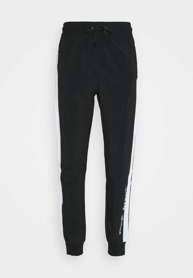 GOTHIC TRACKSUIT PANTS - Teplákové kalhoty - black