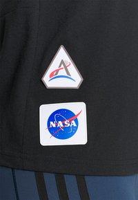 adidas Performance - SPACE TEE - Camiseta estampada - black - 4