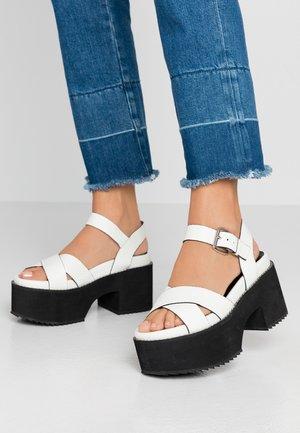 LEATHER PLATFORM HEELED SANDAL - High heeled sandals - white