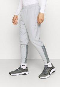 Nike Performance - ESSENTIAL PANT - Tracksuit bottoms - light smoke grey/smoke grey/silver - 0