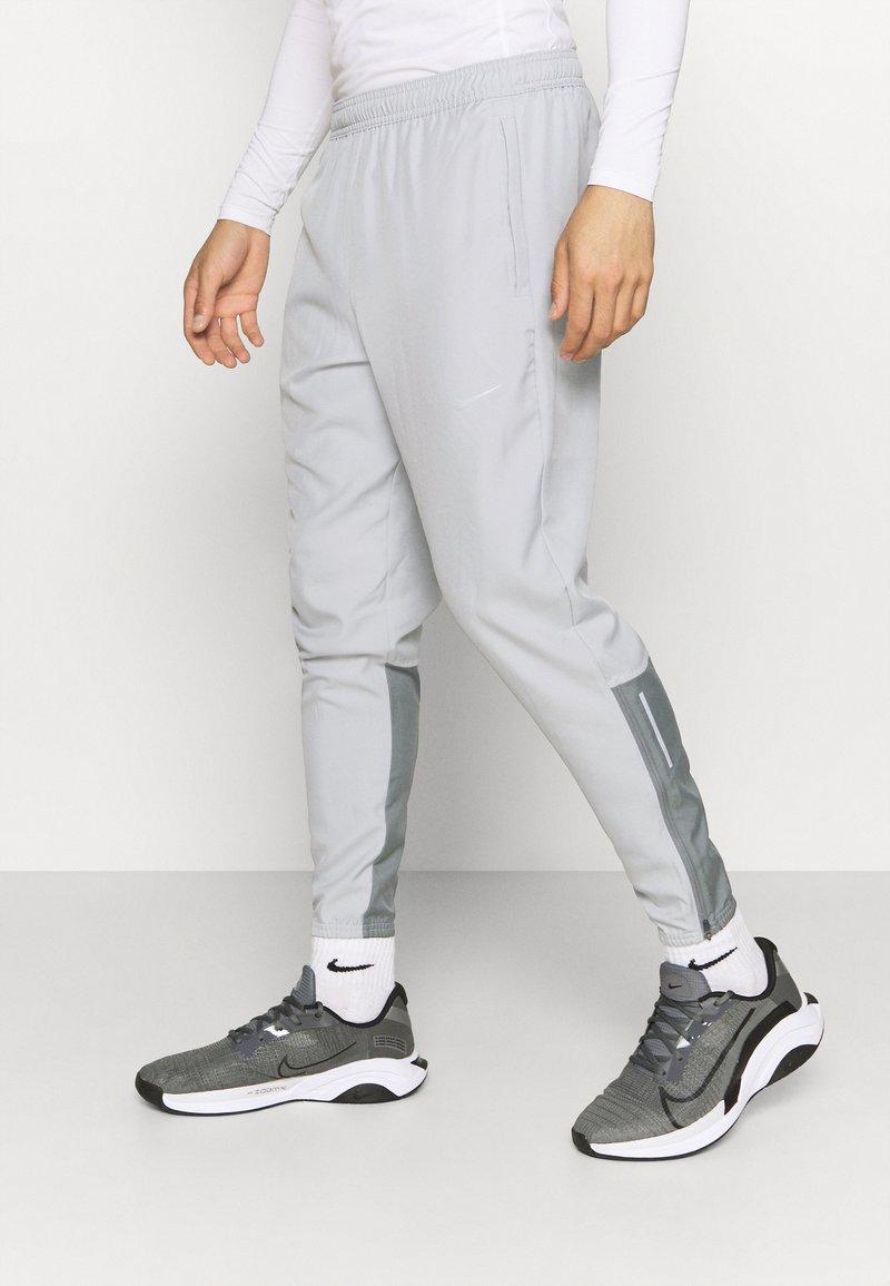 Nike Performance - ESSENTIAL PANT - Tracksuit bottoms - light smoke grey/smoke grey/silver