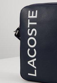Lacoste - VERTICAL CAMERA BAG - Across body bag - dark sapphire - 7