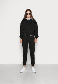 Calvin Klein Jeans - TAPING HOODIE - Hoodie - black - 1