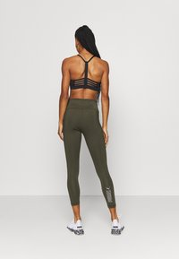 Puma - NU-TILITY HIGH WAIST 7/8 LEGGINGS - Leggings - forest night - 2