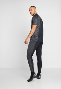 Nike Performance - FC PANT  - Tracksuit bottoms - black/anthracite/white