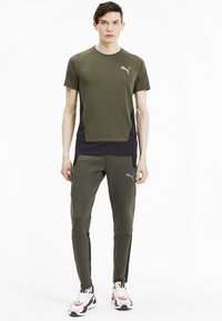 Puma - Tracksuit bottoms - forest night - 1