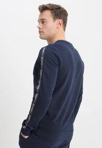 Tommy Hilfiger - TRACK TOP - Pyjama top - blue - 2