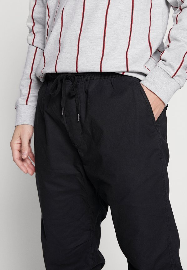 American Eagle Spodnie materiałowe - black/czarny Odzież Męska ROMH