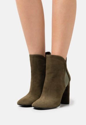 High heeled ankle boots - moss