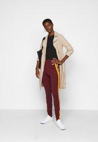 Fila Tall - TASYA - Leggings - Trousers - tawny port/orange popsicle - 1