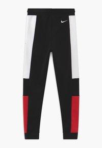 Nike Sportswear - Tracksuit bottoms - black/university red/white - 1