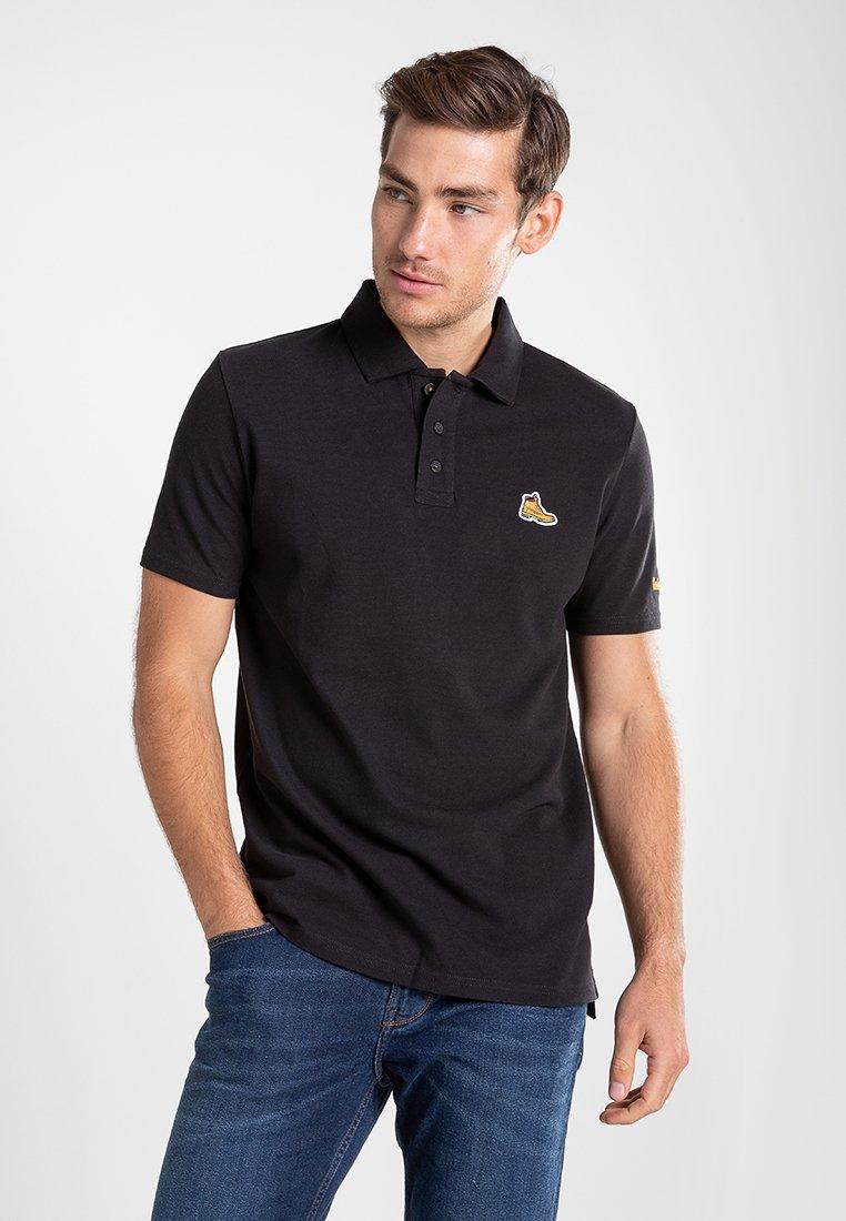 Timberland - BOOT LOGO - Polo shirt - black