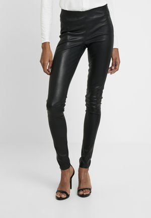 DELTA  - Leggings - Trousers - black