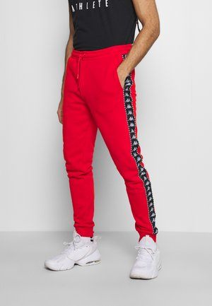 IRENVEUS - Tracksuit bottoms - firey red
