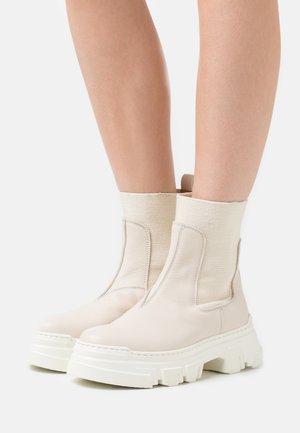 AMELY  - Platform ankle boots - beige