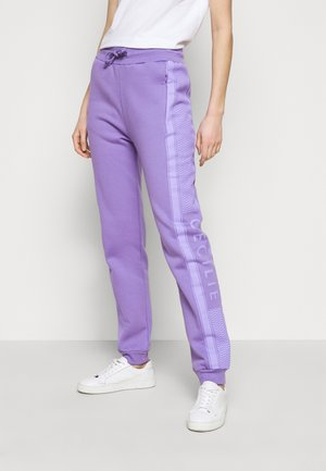 RAMONE  - Tracksuit bottoms - blueberry