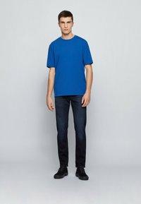 BOSS - Straight leg jeans - dark blue - 1