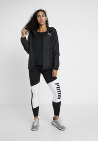 Puma - LOGO GRAPHIC  - Leggings - puma black/puma white - 1