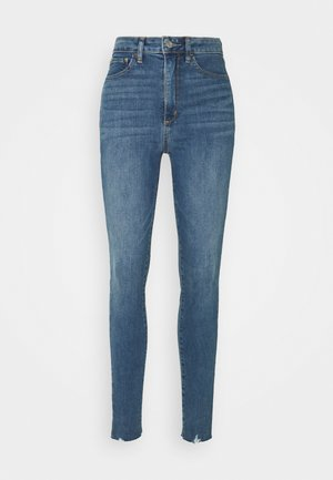 UNIVERSAL JEGGING MED ALFRED  - Slim fit jeans - medium indigo