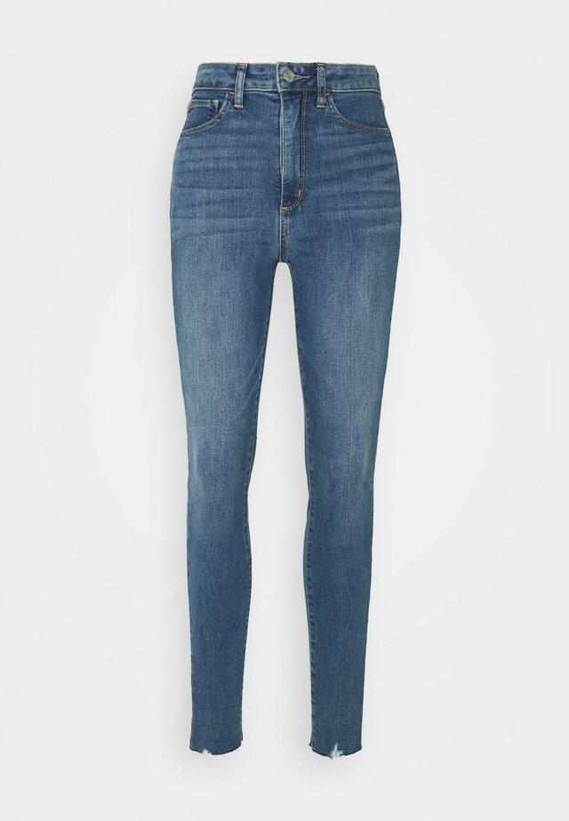 UNIVERSAL JEGGING MED ALFRED  - Slim fit jeans - medium indigo