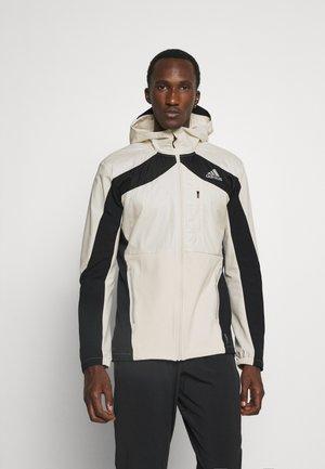 MARATHON RUNNING SUPERNOVA PRIMEBLUE WIND.RDY - Sports jacket - white/black