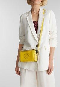 Esprit - FRAN SMALL - Across body bag - brass yellow - 0