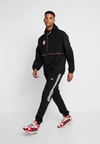 adidas Originals - HOODED JACKET - Windbreakers - black - 1