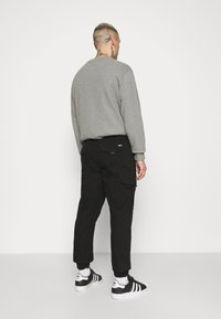 Tommy Jeans - JOGGER - Cargo trousers - black - 2