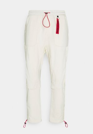 DANGOLIN  - Tracksuit bottoms - natural
