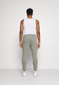 Nike Performance - PANT TAPER - Trainingsbroek - light army/black - 2