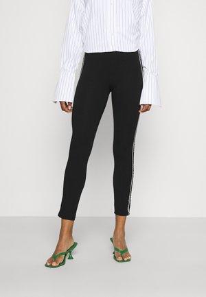 NEW BANDS - Leggings - Trousers - black