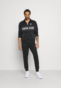 Nike Sportswear - Pantaloni sportivi - black/particle grey/white - 1