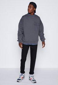 Dr.Denim - CLARK - Jeans Tapered Fit - black - 1