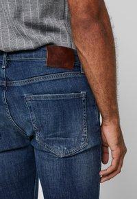 AllSaints - CIGARETTE DAMAGED - Slim fit jeans - indigo - 3