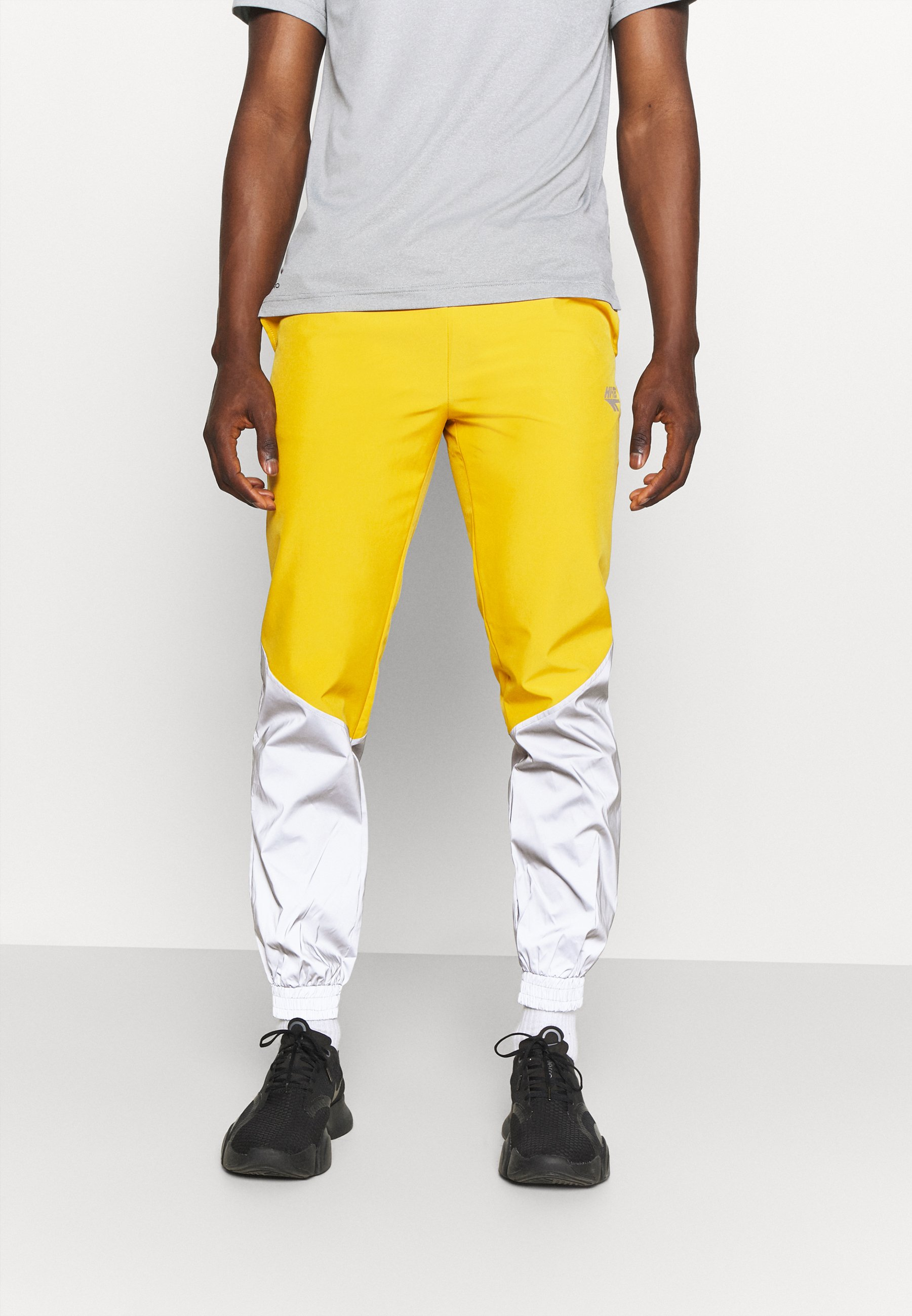 Men FREDERICK REFLECTIVE TRACK PANTS - Trousers