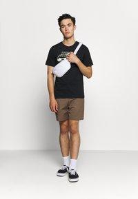 Nike Sportswear - TREND SPIKE - Camiseta estampada - black - 1