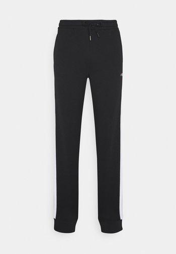LARS  - Pantalones deportivos - black/bright white